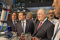 Mr. Robert Hensler with Mr. Johann Schneider-Ammann, Federal Councillor, and M. Mauro Poggia, State Councillor, EPHJ-EPMT-SMT exhibition, June 2017.